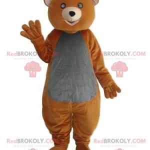 Oranžový a šedý medvěd maskot s dojemným vzhledem -