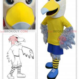 Mascotte d'aigle jaune et blanc en tenue sportive -