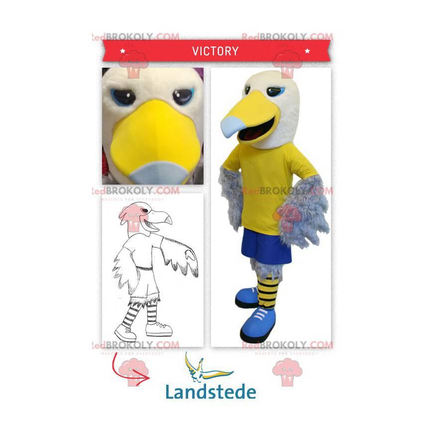 Žlutý a bílý orel maskot ve sportovním oblečení - Redbrokoly.com