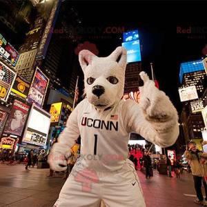 Weißes Wolfshundemaskottchen in der Sportbekleidung -