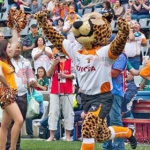 Gepard maskot leopard v sportovní oblečení - Redbrokoly.com