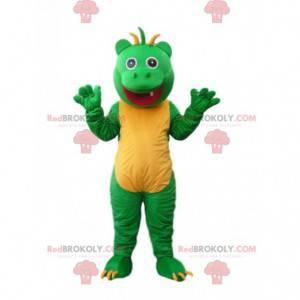 Veselý zelený a žlutý malý monstrum maskot s ofinou na hlavě -