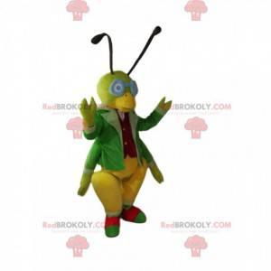 Grünes Heuschreckenmaskottchen mit einem eleganten Kostüm. -