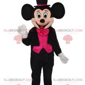 Mascotte Mickey Mouse met een elegant zwart en fuchsia kostuum
