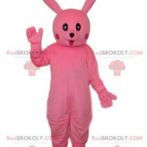 Mascotte de lapin rose avec un regard émerveillé -