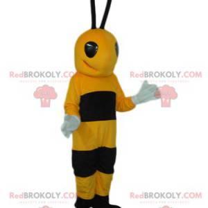 Sehr glückliches schwarzes und gelbes Bienenmaskottchen -