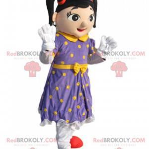 Mascote fada com vestido roxo com bolinhas amarelas -
