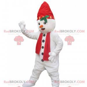 Sneeuwpopmascotte met een hoed en een rode sjaal -