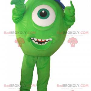 Grønn cyclops maskot med blå hette - Redbrokoly.com