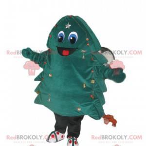 Grün-blaues Tannenmaskottchen mit einem großen Lächeln -