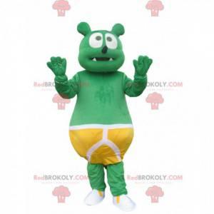 Mascot little green bear with a yellow kangaroo slip -