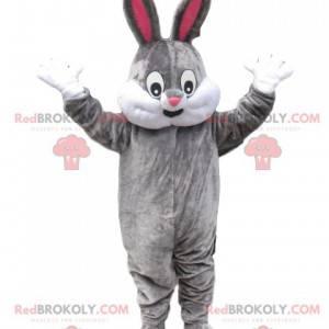 Šedý a bílý králík maskot se širokým úsměvem - Redbrokoly.com