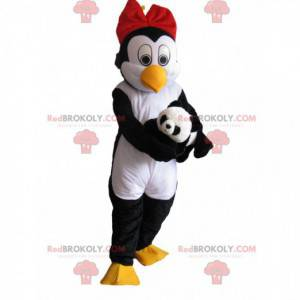 Penguin mascot with a red bow tie and a soft toy -