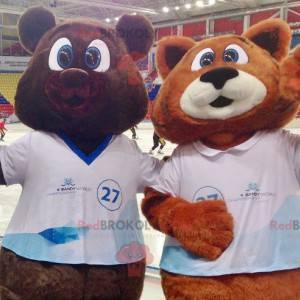 2 maskotki: niedźwiedź brunatny i pomarańczowo-biały lis -