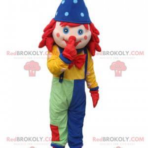 Clown-Maskottchen mit Overall und blauem, spitzem Hut -
