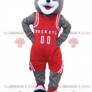 Graues Bärenmaskottchen mit roter Sportbekleidung -