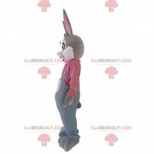Mascotte de lapin gris avec une salopette et une chemise à