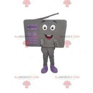 Velmi usměvavý šedý maskot rádia - Redbrokoly.com