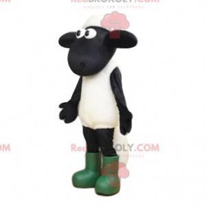Mascotte di pecora bianca e nera con grandi occhi e stivali -