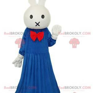 Maskothvit kanin med en blå kjole og en rød sløyfe -