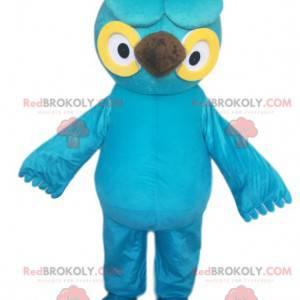 Tyrkysově modrá sova maskot s krásnými žlutými očima -
