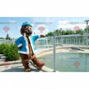 Mascota de morsa marrón con chaqueta azul y gorra -
