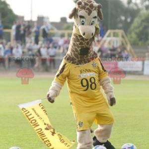 Mascote girafa em roupa esportiva amarela - Redbrokoly.com