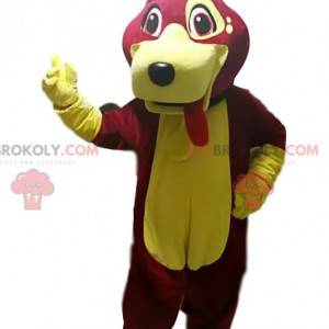 Fuchsie a žlutý pes maskot trčí jazyk - Redbrokoly.com