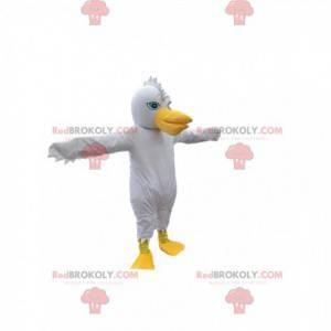 Weißes Vogelmaskottchen mit einem lustigen Wappen und einem
