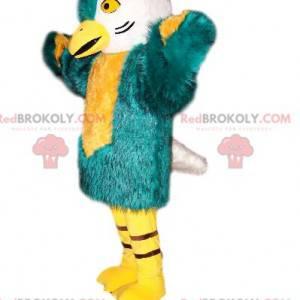Ptačí maskot s krásným modro zeleným a bílým peřím -