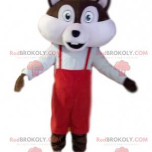 Braunes und weißes Eichhörnchenmaskottchen mit rotem Overall -