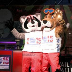 2 mascots a brown dog and a tricolor raccoon - Redbrokoly.com