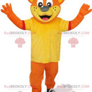 Orange bear mascot with a yellow t-shirt and a red cap -