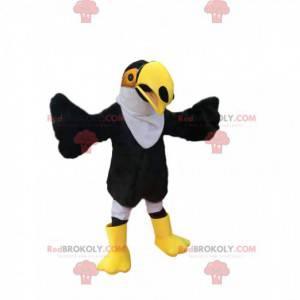 Maskot černobílý Tukan s krásným žlutým zobákem - Redbrokoly.com