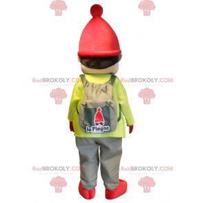 Mały chłopiec maskotka ubrany w strój narciarski -