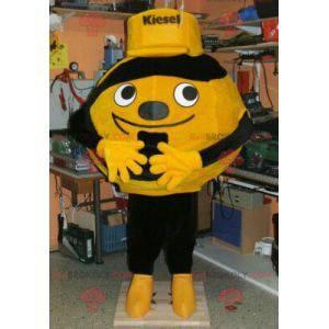 Gelbes oder orange und schwarzes Ballmaskottchen -