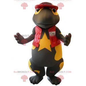 Mascot bastante salamandra negra y amarilla vestida de rojo -