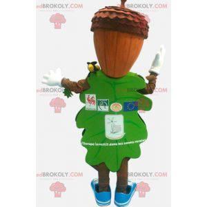 Grünes Blattmaskottchen mit einem eichelförmigen Kopf -