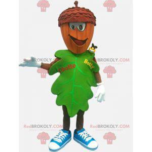 Mascote de folha verde com cabeça em forma de bolota -