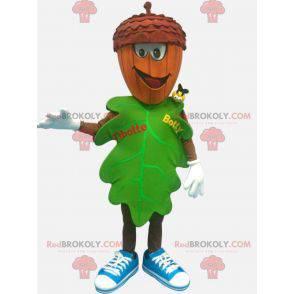 Grønn bladmaskot med et eikenøttformet hode - Redbrokoly.com