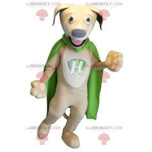 Beige und weißes Hundemaskottchen mit einem grünen Umhang -