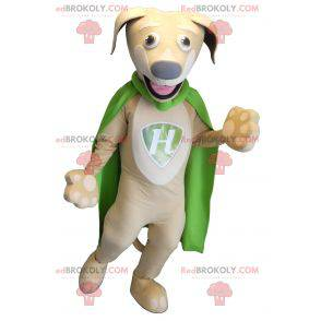 Beige and white dog mascot with a green cape - Redbrokoly.com
