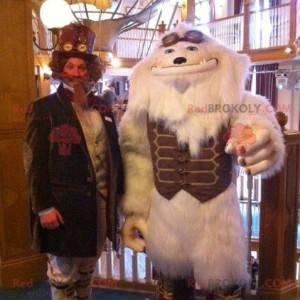 Maskotka biały yeti biały potwór z brązowym strojem -