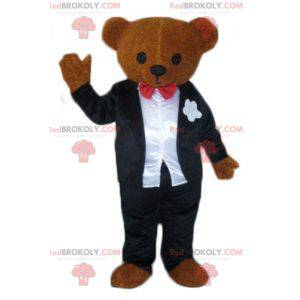 Brown teddy bear mascot dressed in a black and white costume -