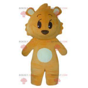 Orange and white teddy bear mascot looking mischievous -