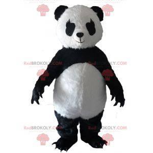 Mascotte del panda in bianco e nero con grandi artigli -