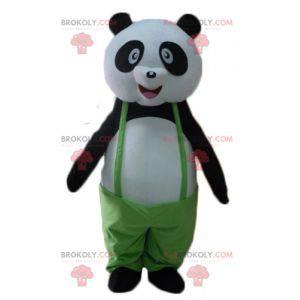 Czarno-biała maskotka panda z zielonym kombinezonem -