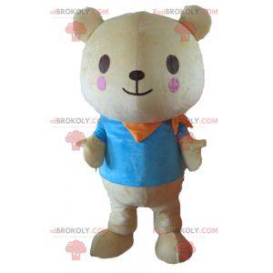 Big beige teddy bear mascot with a blue t-shirt - Redbrokoly.com