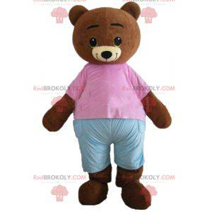 Liten brun bjørn maskot brun med rosa og blå antrekk -