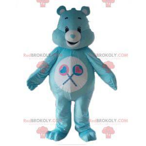 Mascota de oso de cuidado azul y blanco con piruletas -